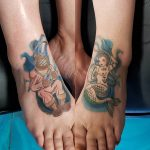 charles tattoo amy's feet with diver and mermaid