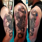 charles tattoo egale snake and american flag on upper arm