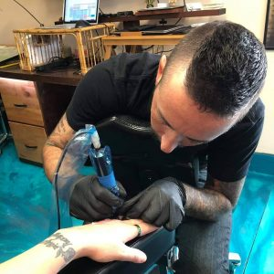 charles tattoo tattooing hand
