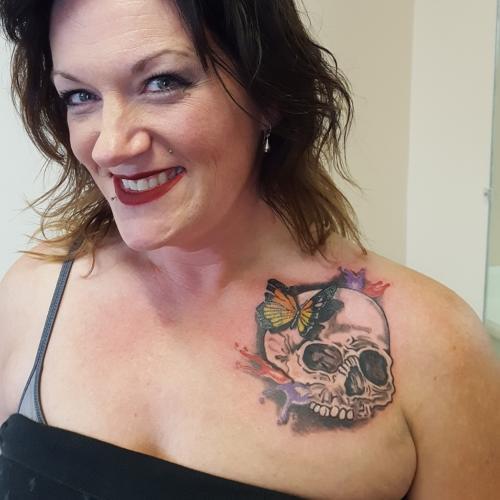 deb fowler chest skull tattoo small