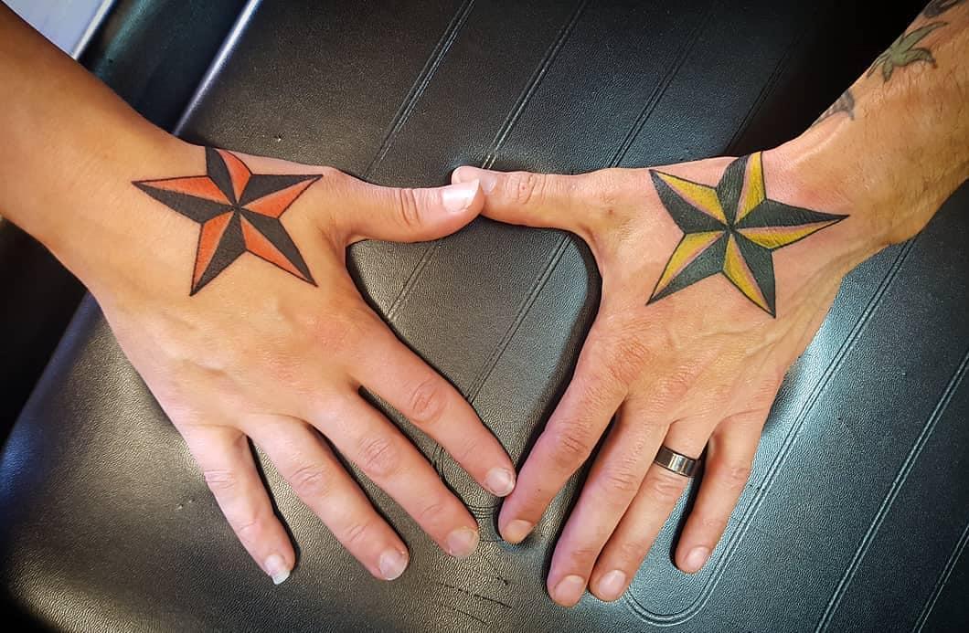 melissa chrysler and matthew devantier hand nautical stars uv blacklight tattoo parlor traverse city northern michigan beauty hair nail salon 2