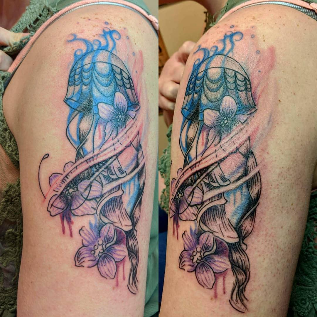melissa riddle jellyfish flower water arm tattoo parlor traverse city northern michigan beauty hair nail salon