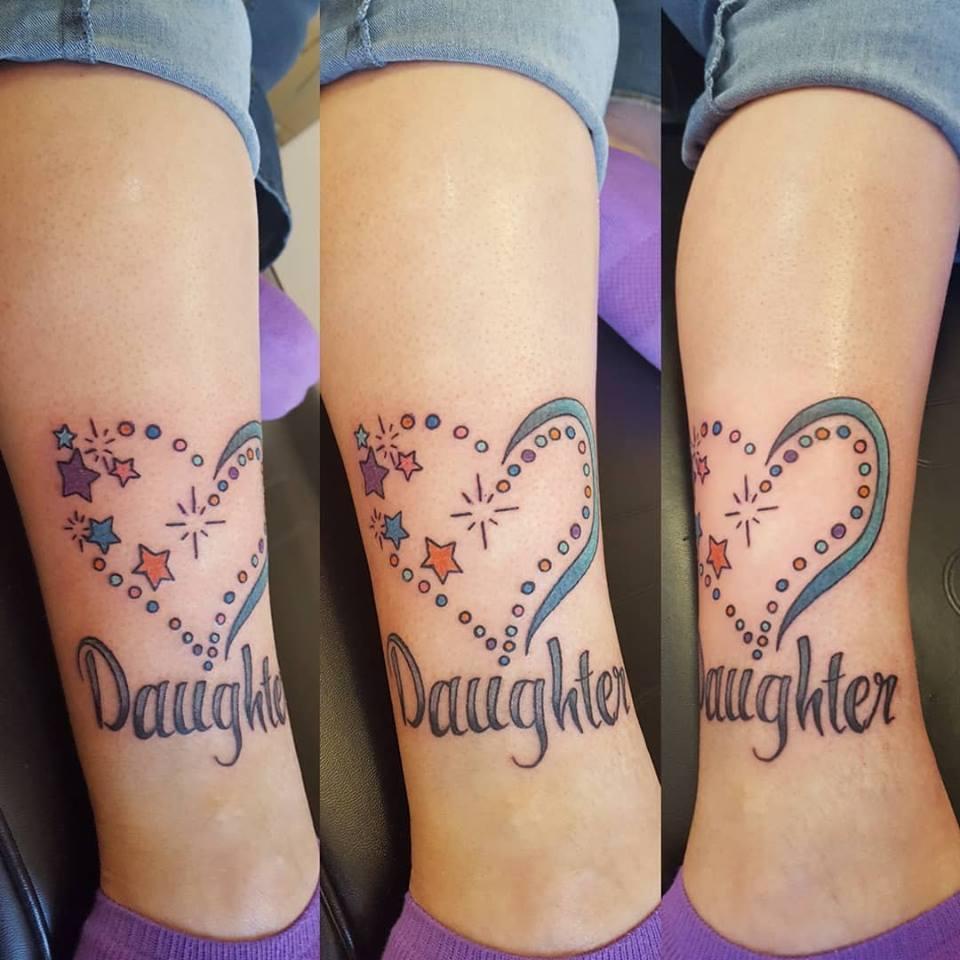 tamra family leg tattoo parlor traverse city northern michigan